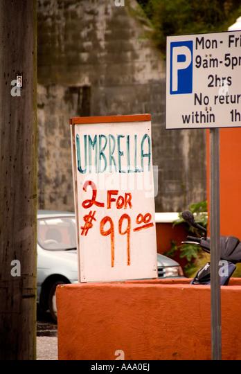 Bermuda Hamilton bad weather humor sign umbrellas 2 for $99 - Stock Image