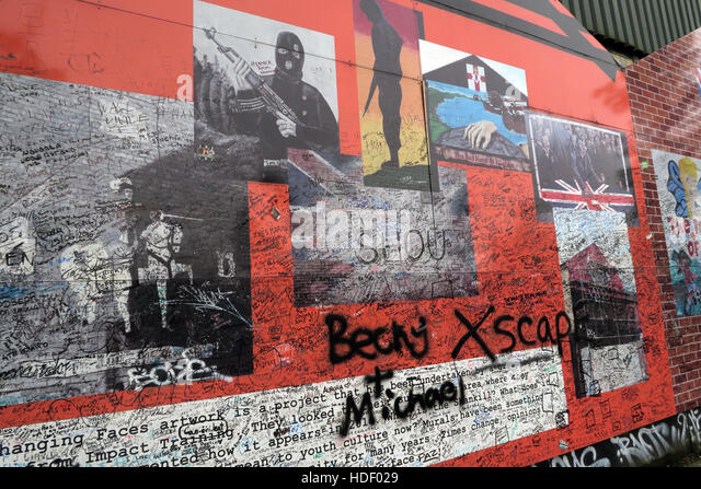 Defaced Unionist Images - Belfast International Peace Wall,Cupar way,West Belfast,NI,UK - Stock Image