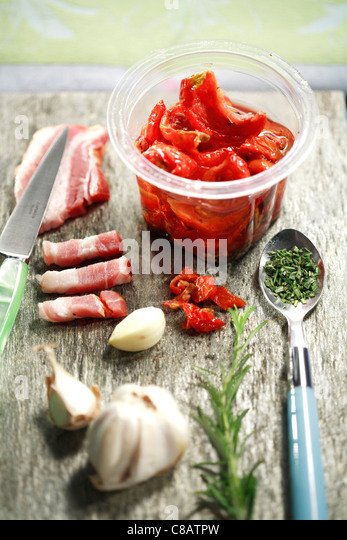 Bacon,dried tomatoes,garlic and rosemary - Stock Image