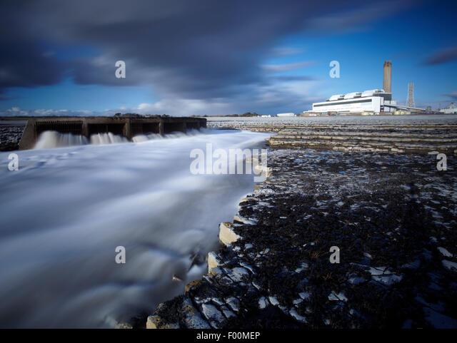 Aberthaw coal fired power station, with the warm water outflow shown in foreground, Vale of Glamorgan, South Wales. - Stock Image