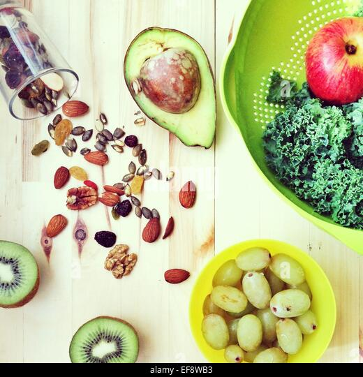 Fruit, vegetables and mixed nuts - Stock Image