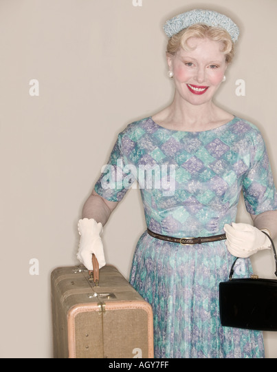 A retro woman leaving on a trip - Stock Image