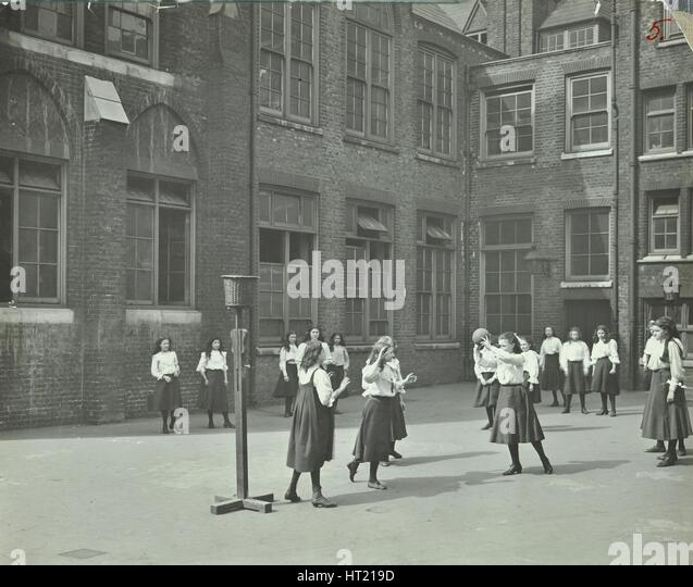 Girls playing netball in the playground, William Street Girls School, London, 1908. Artist: Unknown. - Stock Image