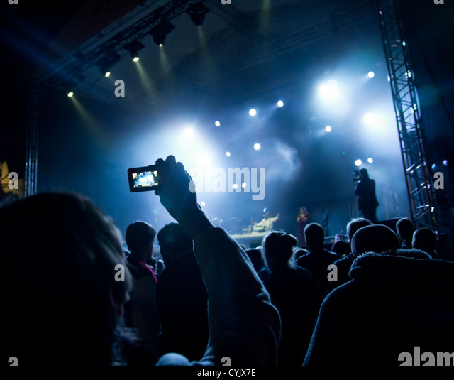 people watching open air concert - Stock Image