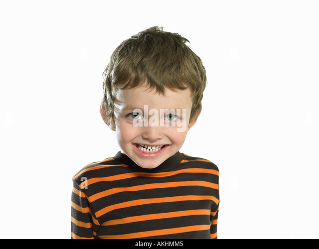 Cheeky looking boy - Stock Image