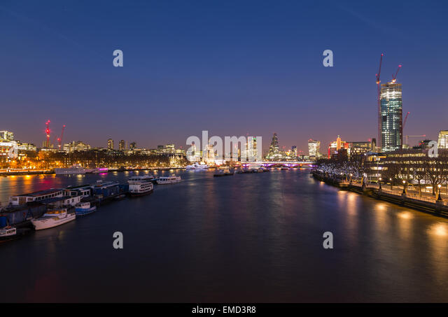 The City of London Skyline at Dusk showing boats, buildings and construction. There is copy space in the image. - Stock Image