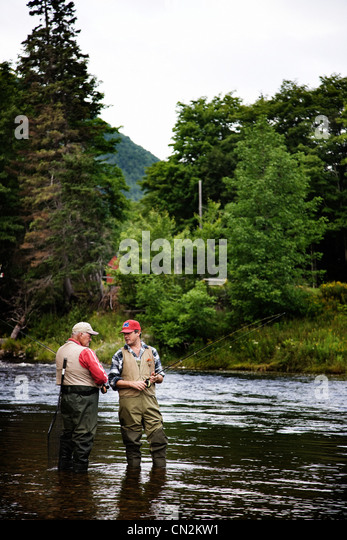 Fly fishermen in Margaree River, Cape Breton Island, Nova Scotia - Stock Image