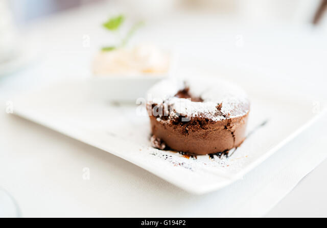 Beautiful soufflé and vanilla ice cream served in restaurant - Stock Image