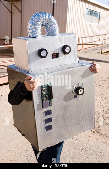 child wearing robot costume for Halloween parade at school - Stock Image