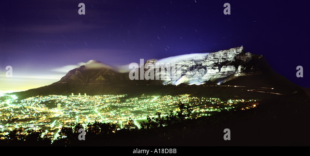Cape Town at night backed by floodlit Table Mountain South Africa - Stock Image