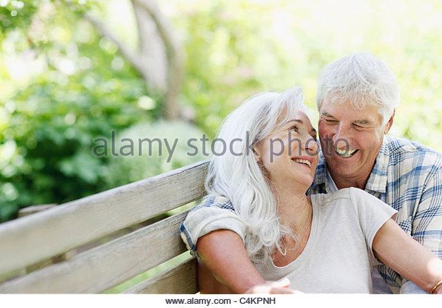 Senior couple on bench - Stock-Bilder