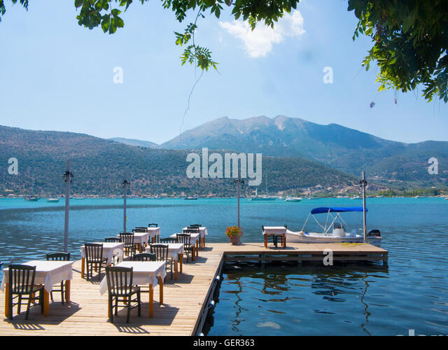 A restaurant with moorings in Greece - Stock Image