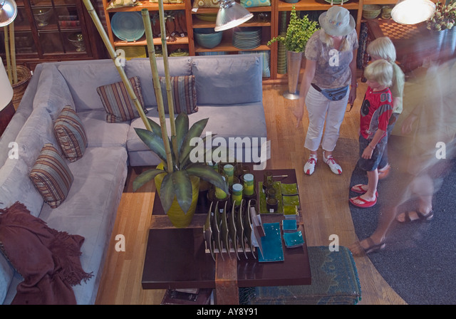 People, resting, standing sofa pointing at  furniture   family movement, blur Pasadena California, couples, shopping, - Stock Image