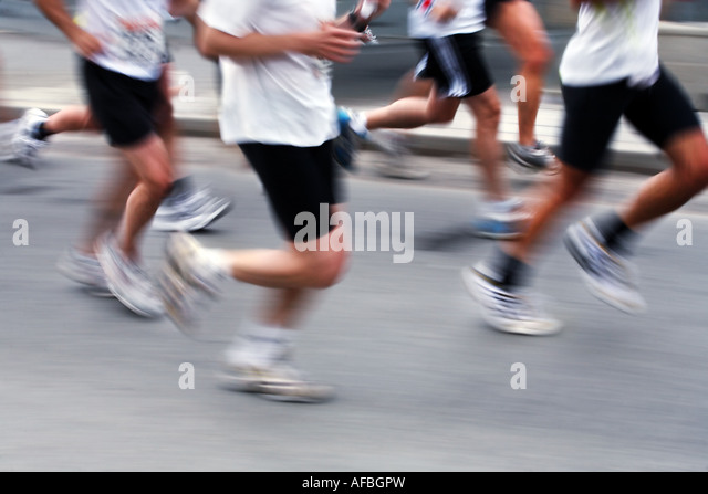 Marathon runners blurred motion - Stock Image