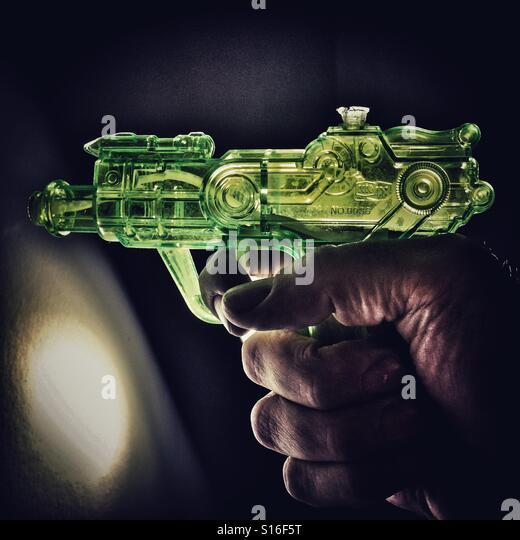 Green plastic water pistol - Stock-Bilder