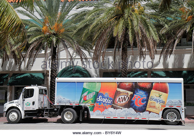 Miami Beach Florida semi tractor trailer truck delivery drinks advertising - Stock Image
