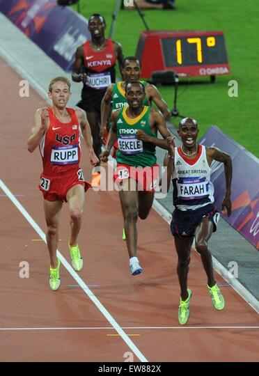 Mo Farah wins the 10000m from Galen Rupp and Kenenissa Bekele on Super Saturday at the Olympics games in London - Stock Image