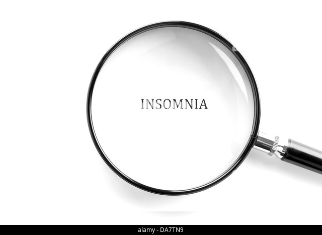 Concept photo showing the word insomnia with magnifying glass over it - Stock Image