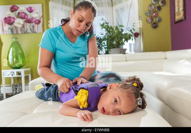 Mother caring for daughter with Cerebral Palsy - Stock Image