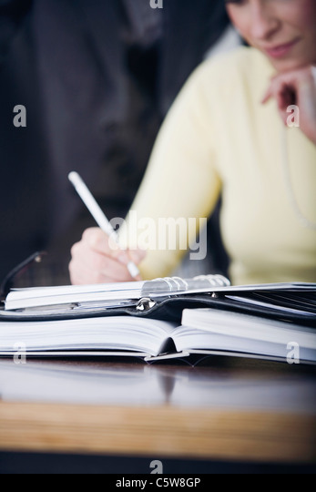 Germany, Business woman with diary - Stock Image