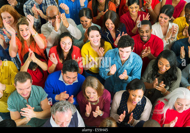 Diverse crowd clapping - Stock Image
