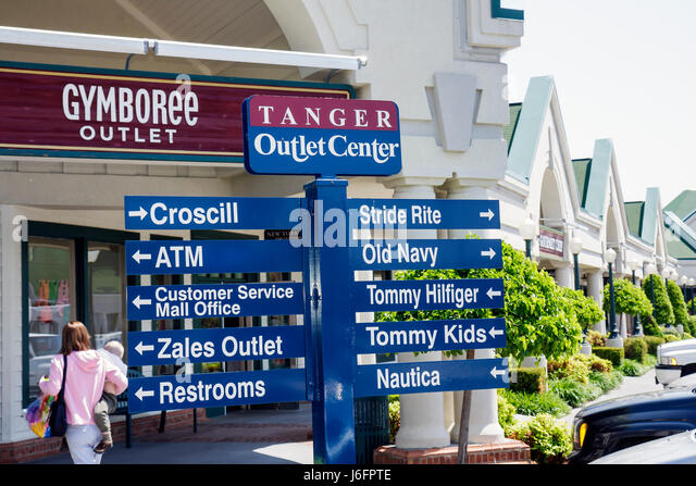Tennessee Sevierville Tanger Outlets at Five Oaks shopping woman boy mother carries toddler outdoor mall retail - Stock Image