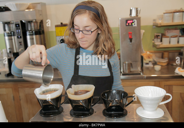 Washington DC Eastern Market 7th Street NE coffee shop barista woman brewing slow drip caffeine - Stock Image