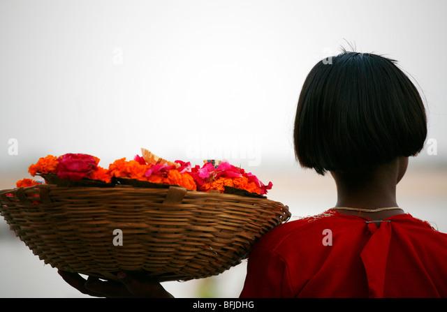 back of girl flower seller - Stock-Bilder