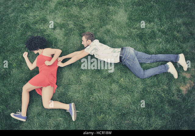 Boy and girl in the grass - Stock Image