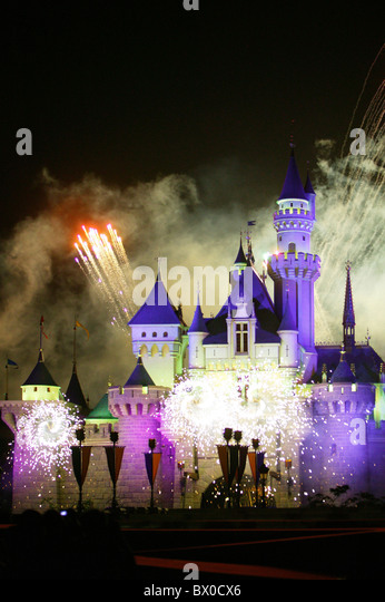 Fireworks light up the Sleeping Beauty Castle, Fantasyland, Hong Kong Disneyland, Lantau Island, Hong Kong, China - Stock-Bilder