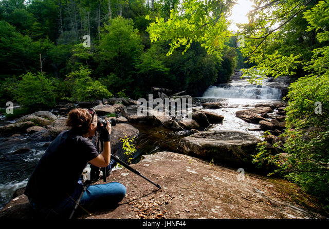 Photographer at Stairway Falls - Gorges State Park (Pisgah National Forest) near Sapphire, North Carolina, USA - Stock Image