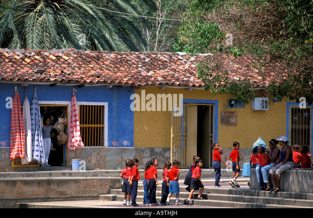 Isla Margarita island Venezuela school children in red shirts - Stock Image