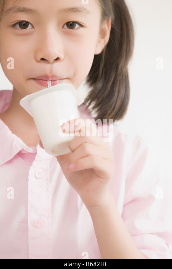 Portrait of a girl drinking milkshake - Stock Image