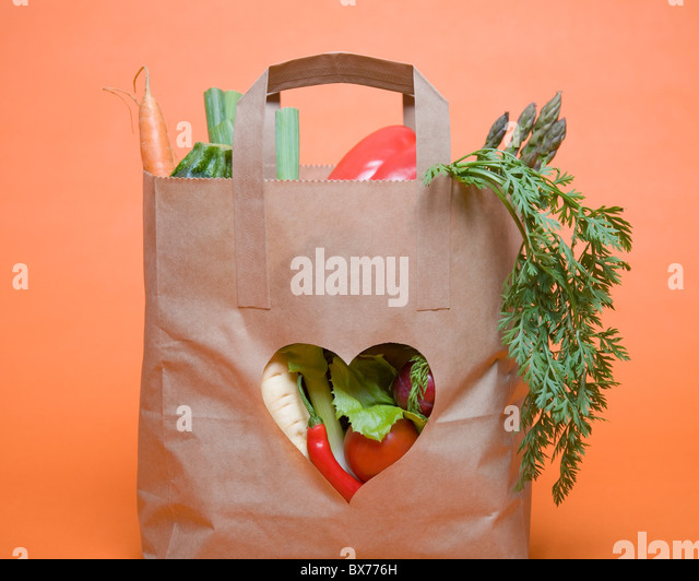 Vegetables in bag with heart symbol - Stock-Bilder