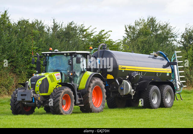 Klause 640 Arion tractor with Connor 3500T tanker at Llanigon YFC Show 2016 nr Hay-on-Wye Powys Wales UK - Stock Image