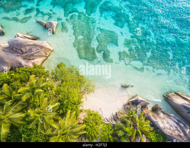 Aerial photo of Seychelles tropical beach Anse Source D Argent at La Digue island - Stock Image