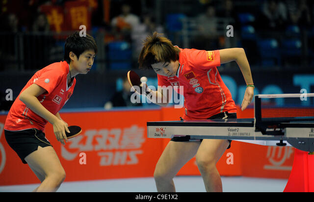 Yue GUO (CHN) and and Xiaoxia LI (CHN)  during the ITTF Table Tennis Tour Grand Finals, ExCel Centre,  London, England - Stock Image