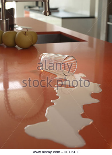 Spilled milk on kitchen counter - Stock Image