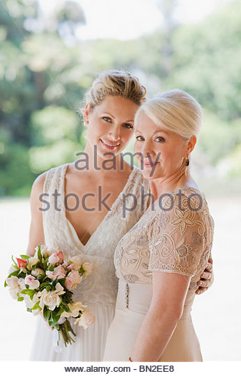 Mother and bride hugging - Stock Image