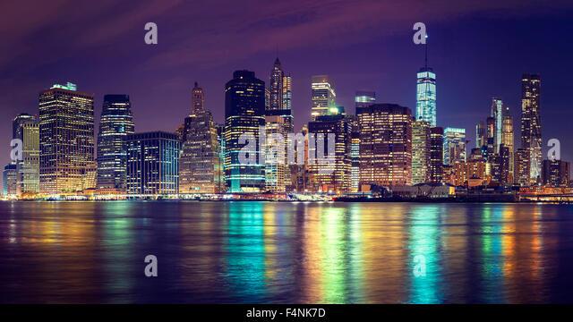 Vintage toned Manhattan skyline at night, NYC, USA. - Stock Image