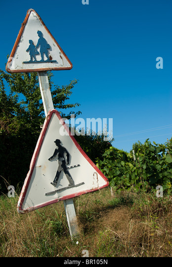 An old cross road sign - Stock Image