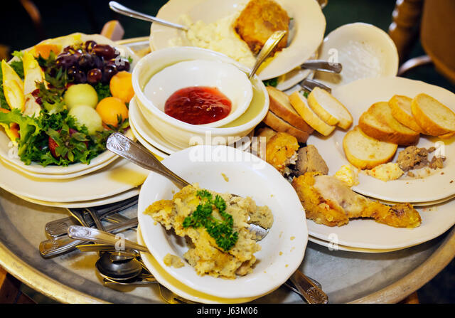 Michigan Frankenmuth busboy tray dirty dishes uneaten waste food plates silverware - Stock Image