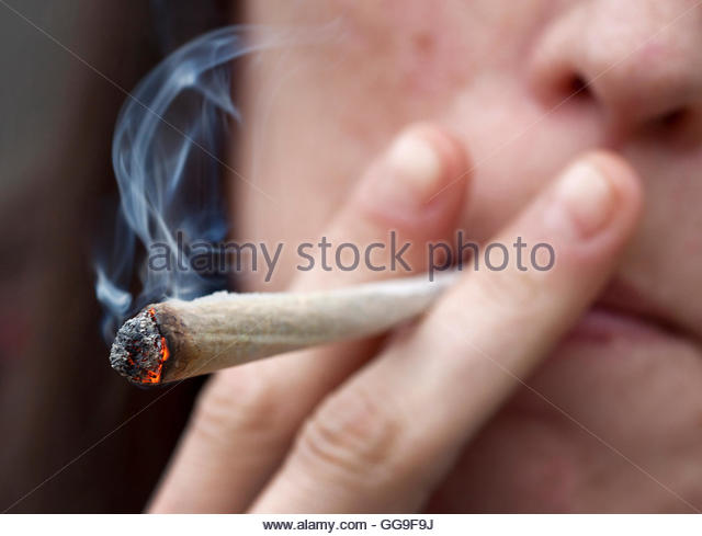 Heidi from Limburg, Belgium, smokes a joint in the Toermalijn coffee shop in Tilburg April 29, 2012. A controversial - Stock Image