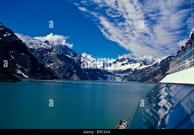 Alaska cruise ship entering Glacier Bay passengers on deck railing view glaciers blue ice - Stock Image