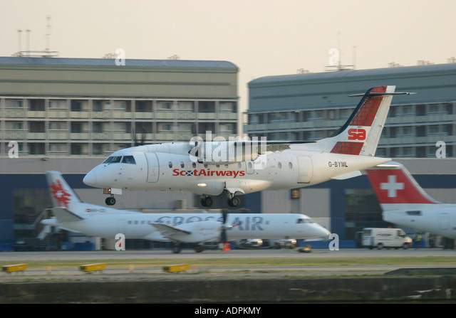 Scot Airways Dornier 328 landing at London City Airport, England, UK. - Stock Image