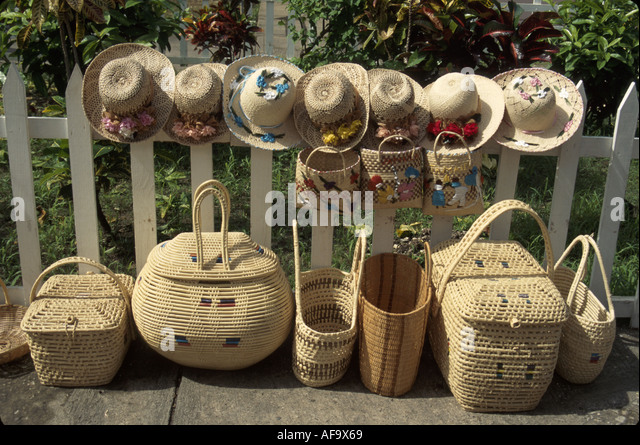 Jamaica Montego Bay Harbour Street Craft Market wicker basket straw hats for sale picket fence display - Stock Image