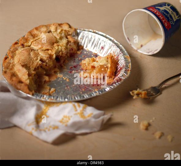 Messy half eaten apple pie - Stock Image