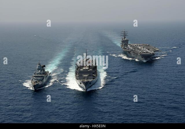 The German navy frigate FGS Hamburd (F220), the aircraft carrier USS Dwight D. Eisenhower (CVN 69), and the Military - Stock Image