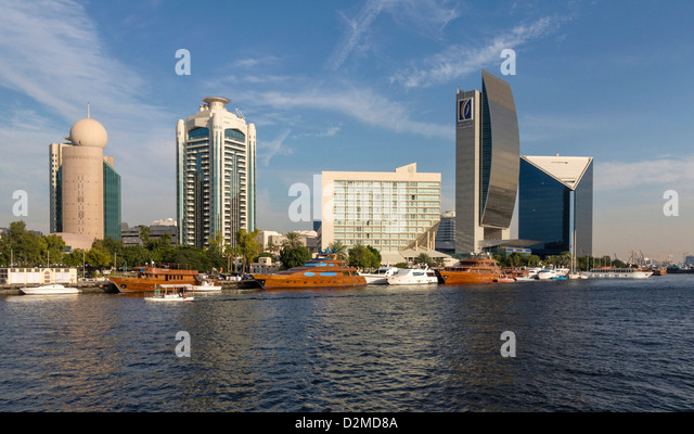 Buildings inc Sheraton Hotel, Bank of Dubai and the Dubai Chamber of Commerce (last 3 buildings on right) across - Stock Image