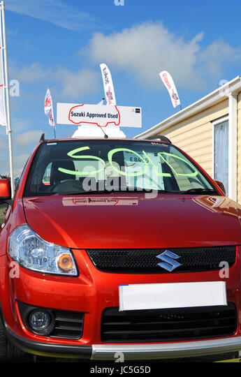 used car sold sign second hand car sales - Stock Image